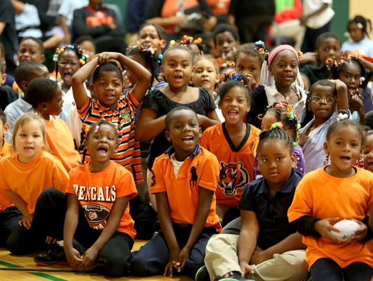 Pleasant Hill Academy students cheer as their classmates play a game with former Bengals player Andrew Whitworth, who encouraged the students during the Learning is Cool program sponsored by the Marvin Lewis Community Fund.