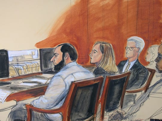 In this courtroom artist's drawing, Ahmad Khan Rahimi,