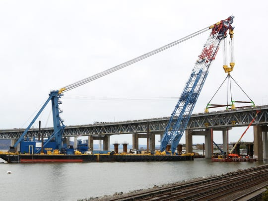 The Left Coast Lifter prepares to remove a piece of