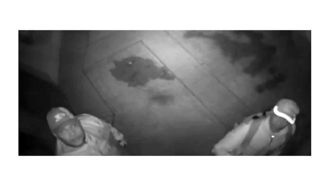Surveillance photos show two men who Indianapolis police say are suspects in the burglary of Indiana Pacer Paul George's home.