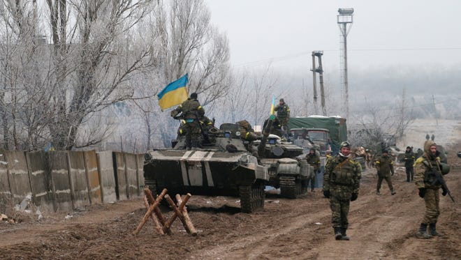 Ukrainian government soldiers park their vehicles near the road between the towns of Dabeltseve and Artemivsk, Ukraine, on Feb. 14, 2015.