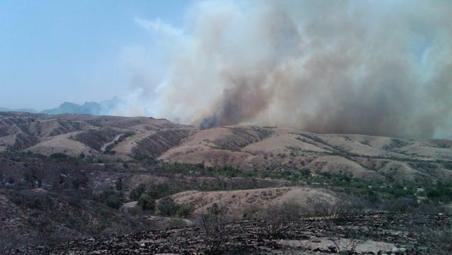 A wildfire rages on a nearby ridge in June of 2011.