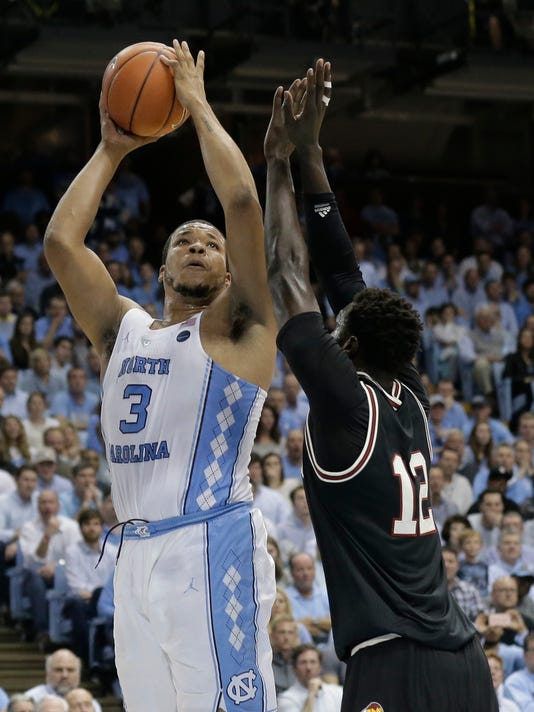 FILE- In this Feb. 22, 2017, file photo, North Carolina's Kennedy Meeks (3) shoots as Louisville's Mangok Mathiang (12) defends during the first half of an NCAA college basketball game in Chapel Hill, N.C. The 6-foot-10 senior is averaging 9.1 rebounds to help the Tar Heels lead the country in rebounding margin entering the Friday, March 24, game against Butler in the NCAA Tournament's South Region semifinals. (AP Photo/Gerry Broome, File)