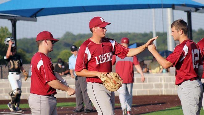 Fort Osage graduate Bryce Dye, center, high-fives a Legends teammate after a recent win in the Ban Johnson League. After having his sophomore season at Park University cut short by the coronavirus, Dye, who is hitting .348 for the Legends this summer, is already closing in on the career home run at Park after just one and a half seasons at the NAIA school.