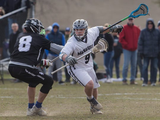 Manasquan's Canyon Birch dives in towards the goal