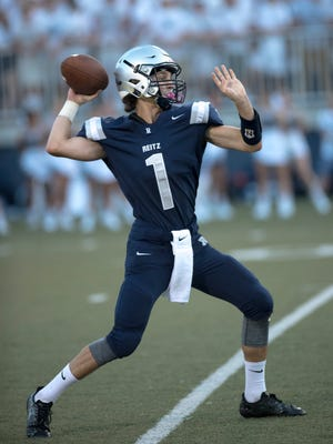 Reitz Quarterback Eli Weithop (1) makes a throw against the Henderson County Colonels at the Reitz Bowl Friday night.