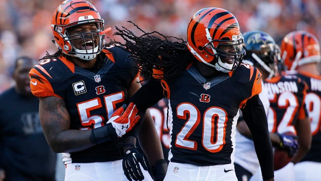 The Cincinnati Bengals free safety Reggie Nelson (20) and outside linebacker Vontaze Burfict (55) celebrate after a third quarter third down stop against the Baltimore Ravens at Paul Brown Stadium.