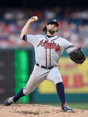 Atlanta Braves starting pitcher R.A. Dickey delivers during the second inning of a baseball game against the Washington Nationals, Friday, July 7, 2017, in Washington. (AP Photo/Nick Wass)