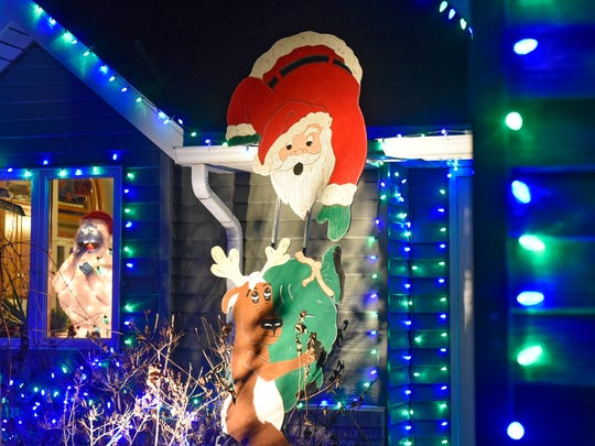 A hand-painted decoration is one of several Christmas