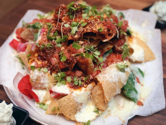 "The ""Italian Nachos"" with house made tortilla chips,"