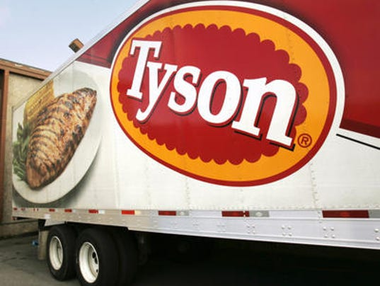 A Tyson Foods Inc., truck is parked at a food warehouse in Little Rock, Ark. Tyson Foods said Monday that its second-quarter net income more than doubled, benefiting from strong demand for chicken and higher prices for beef and pork.