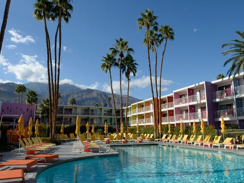 Technicolor watermelon, lime, tangerine and royal purple hues adorn the walls of the Saguaro Hotel.