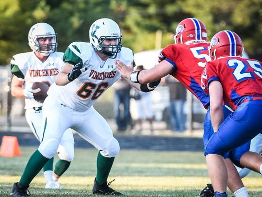 Vincennes Lincoln senior Graham Toole drops back to