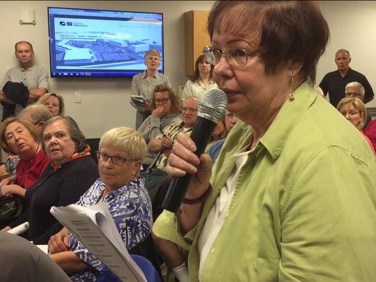 Essex resident Paula DeMichele discusses a proposed