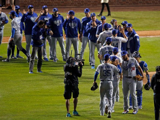 Los Angeles Dodgers relief pitcher Kenley Jansen (74) celebrates with his teammates after Game 3 of baseball's National League Championship Series against the Chicago Cubs, Tuesday, Oct. 17, 2017, in Chicago. The Dodgers won 6-1. (AP Photo/Charles Rex Arbogast)