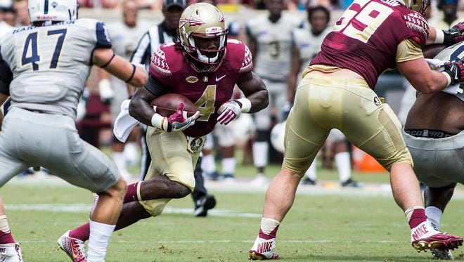 Florida State running back Dalvin Cook carries the ball against Charleston Southern in the first half at Doak Campbell Stadium.
