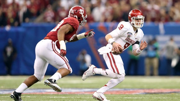 Oklahoma quarterback Trevor Knight tries to elude Alabama defensive lineman Jonathan Allen during the 2014 Sugar Bowl, in which the Crimson Tide lost.