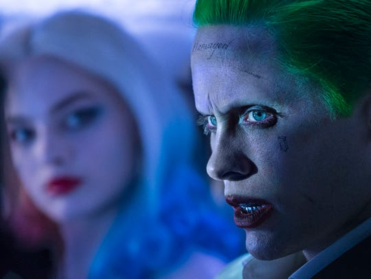 Harley Quinn (Margot Robbie) and Joker (Jared Leto)