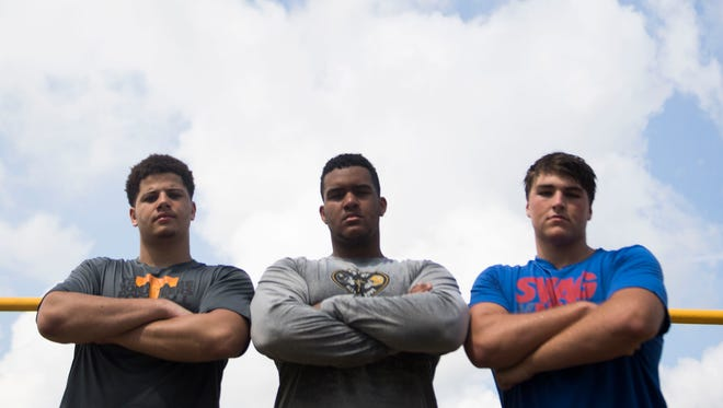 Catholic linemen Stiles Moore, left, Bryn Tucker, center, and Cooper Mays, right, pose after a practice at Knoxville Catholic on July 23, 2018.