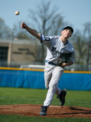 Webster Schroeder's Josh Simons pitches against Penfield in the first inning during a home game.