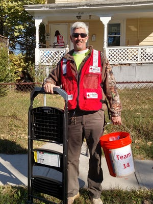 Volunteer Donald Judge is going door-to-door to help test and install smoke alarms in Asbury Park residents.