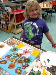 Jaelynn Mackoski, adding finishing touches to her 'masterpiece'