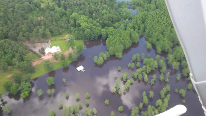 A flooded area of the Black and Clear lakes area of Natchitoches Parish can be seen in this aerial photo taken Tuesday. Sandbags are available for parish residents who need them.