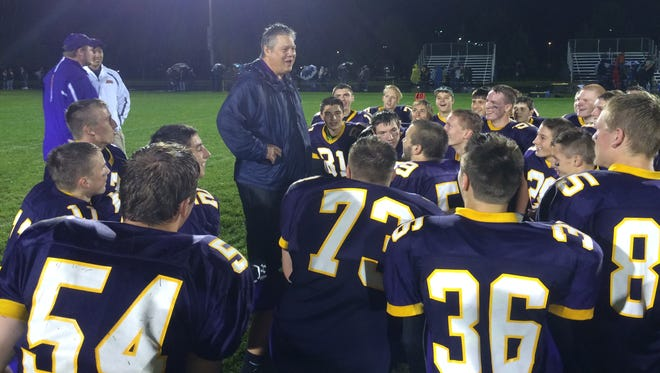 Kewaunee football coach Kurt Flaten talks to his players following a 30-12 victory over Algoma.
