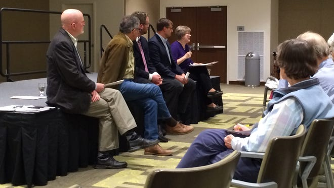 Five candidates bidding for seats on the Iowa City Council met with Oaknoll residents in the new Spring Street addition on Wednesday.
