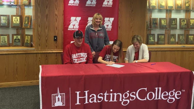 Columbus Catholic senior Jessica Trad signed a national letter of intent to play basketball at Hastings College (Neb.) next year. Trad, an all-Cloverbelt Conference East Division first team selection last year, will be competing at the NAIA level in the Great Plains Athletic Conference. Pictured with Jessica are her parents Michael and Suzan Trad and Hastings coach Jina Johansen.