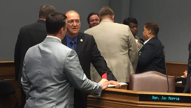 Rep. Jack Montoucet, D-Crowley, shown here talking with a lobbyist outside of a committee hearing Tuesday, says he is inclined to pull his House bill that would amend current law to allow disabled people to have service monkeys.