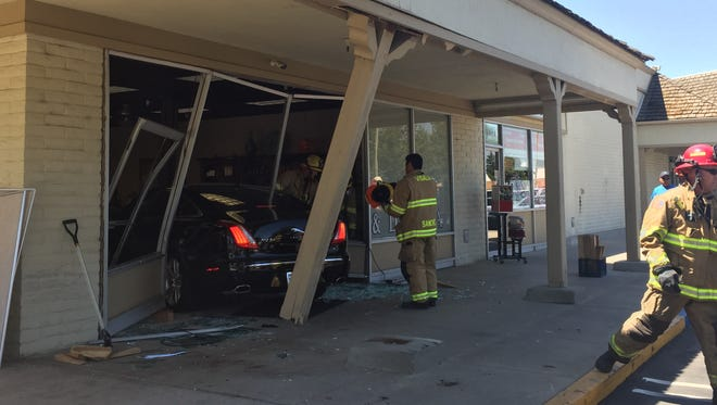 A woman crashed her car into Expose Hair Salon in Visalia.
