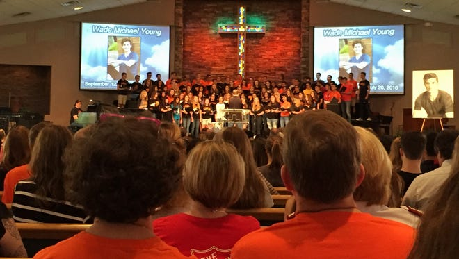 The Corona del Sol a cappella choir sings Aug. 6, 2016, at Arizona Community Church in Tempe during a celebration of life for Wade Young, who died July 20.