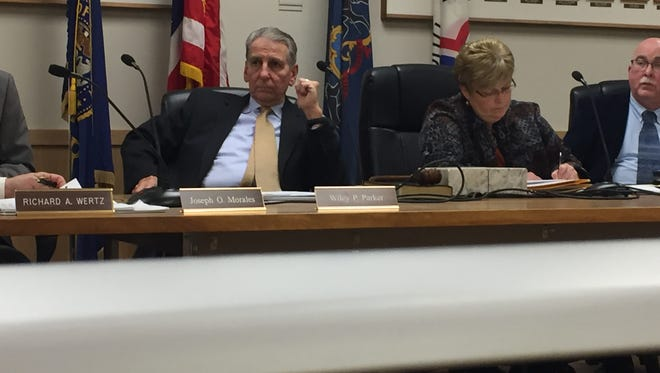 City Council Chairman Wiley Parker, seated next to city clerk Cheryl Gibson, convinced city council to approve a salary increase for council members and the mayor effective January 2018. The salary for councilpersons has not been increased since 1993, and the mayor's salary has not been increased since 2008.