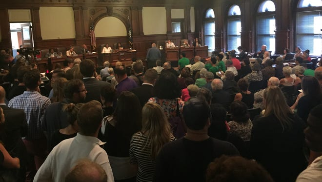 An overflow crowd packed the Rochester City Council Chambers on Thursday for a public forum on downtown, Parcel 5 and a proposed theater project.