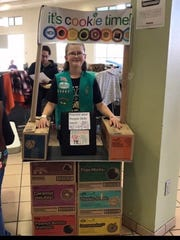 Girl Scout Sidney Rinepold, 9, is ready to sell cookies