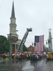 An American flag is hung as the body of York City Police