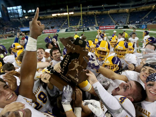 Warren De La Salle celebrates its 44-8 win over Muskegon Mona Shores in the Division 2 state title game on Nov. 28, 2014, at Ford Field.