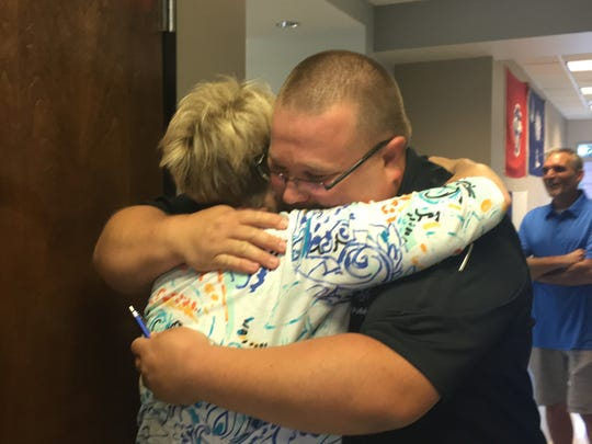 Connie Dudley hugs AEMT Travis Rorabaugh when the Dudley family visited the Rutherford County Special Operations Response Team headquarters in Murfreesboro to thank the team for saving her husband's life.