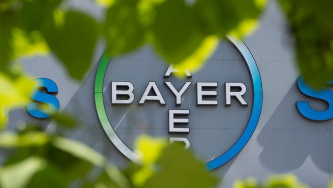 This file photo taken on July 24, 2013 shows a logo of German pharmaceuticals and chemicals giant Bayer on an overpass at its Berlin headquarters.