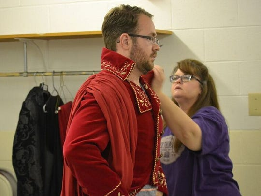 "Sharing the role of the Phantom in USM's production of ""The Phantom of the Opera"" is Harlan Mapp, a master's student from Hattiesburg. Assisting Mapp with his costume is Tammy Mansfield, a costume coordinator, also from Hattiesburg."