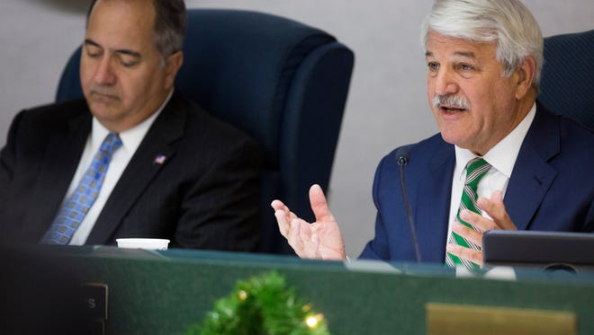 District 3 Commissioner Burt Saunders, right, speaks during a Board of County Commissioners Meeting Tuesday, Dec. 13, 2016 in Naples.