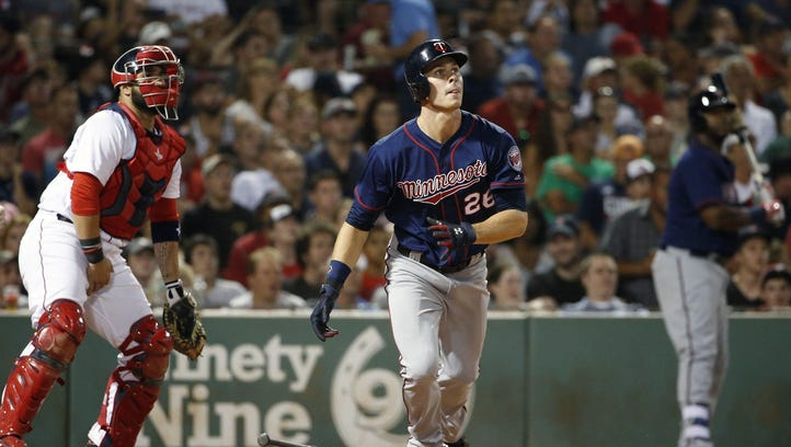The Minnesota Twins' Max Kepler (26) watches his RBI triple in front of the Boston Red Sox's Sandy Leon during the seventh inning Saturday in Boston.