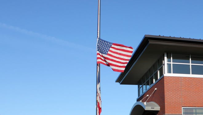 The U. S. flag is flown at half-staff at the Ankeny Fire Station.