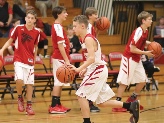 FMS boys basketball players during warm-up session.