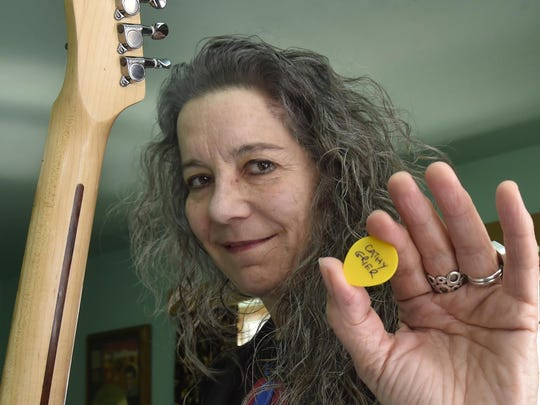 Blues artist Cathy Grier of Sturgeon Bay heads to Memphis this week to compete in the International Blues Challenge. For the occasion, she's bringing along personalized guitar picks.