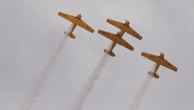 The Canadian Harvard Aerobatic Team performs during  #ThunderOverLouisville airshow.