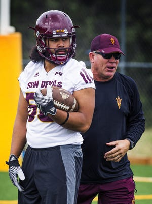 Arizona State University linebacker Salamo Fiso , left , waits for a drill to begin in practice at Rumsey Park in Payson, Wednesday, August 3, 2016.