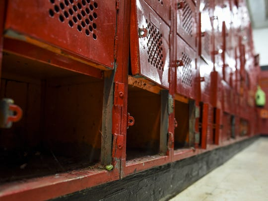 Broken and damaged lockers in the boys' locker room go unused at Simon Sanchez High School in Yigo on Oct. 1, 2015.
