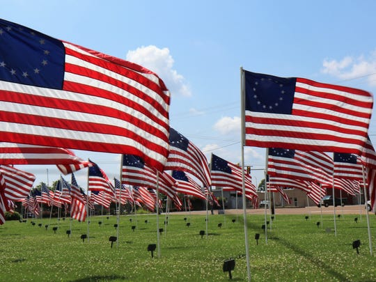 The Betsy Ross Flags, that were added to the Field